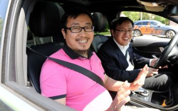 Chinese business people looking forward to trying out the off-road course at the Mercedes-Benz plant in Bremen