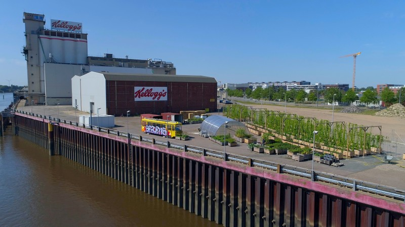 View of the old Kellogg's site, where the new urban quarter Überseeinsel is to be built. In the foreground you can see an area where hops and vegetables are grown.