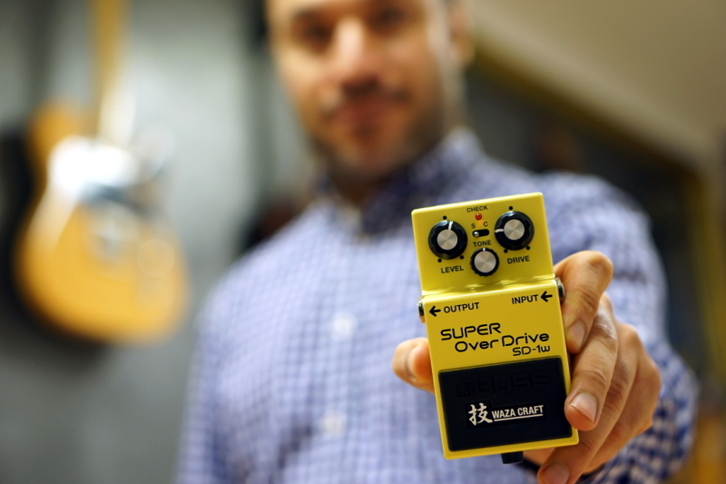 Hajo holding an effect product