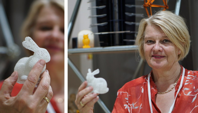 Antje Moebus holding an intricate, 3D-printed hare